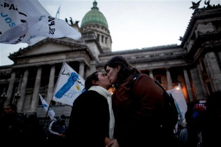 A gay couple kisses outside Argentina's congress during a rally to support a proposal to legalize same-sex marriage in Buenos Aires, Wednesday, July 14, 2010. On Wednesday, senators are expected to vote over the bill which would make Argentina become the first Latin American country to legalize same sex marriage.(AP Photo/ Natacha Pisarenko)
