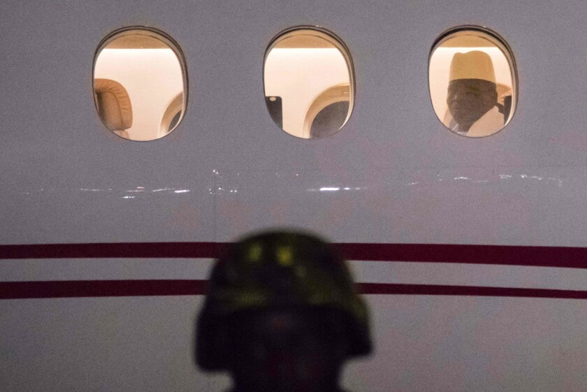 Yahya Jammeh, Gambia's defeated president, flew out of the country Saturday after trying to cling to power despite losing elections last month.