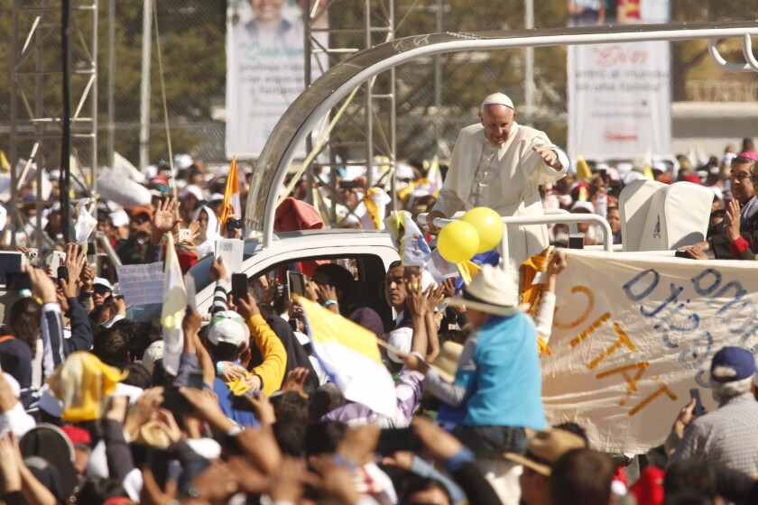 SAN CRISTOBAL DE LAS CASAS, MEXICO - FEBRUARY 15, 2016 - Pope Francis waves to pilgrims as he rides through the crowd of pilgrims at the Municipal Sports Center in San Cristobal de las Casas, Mexico, on February 15, 2016.(Genaro Molina / Los Angeles Times)