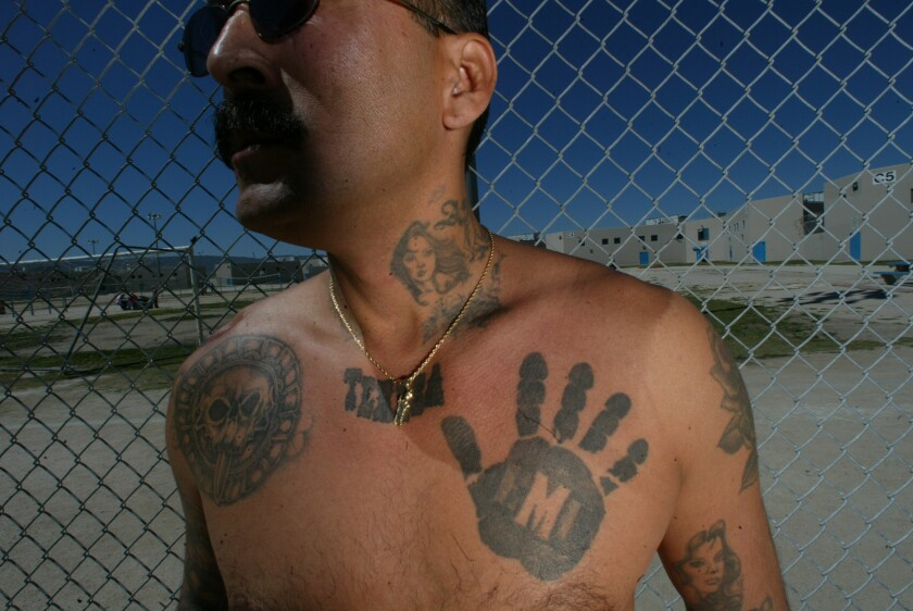 """Showing a """"Black Hand"""" tattoo of the Mexican Mafia, Rene Enriquez, former member of the group, talks at the state prison in Lancaster about the development of the underground criminal organization. He is serving life for two murders committed while he was part of the Mexican Mafia."""