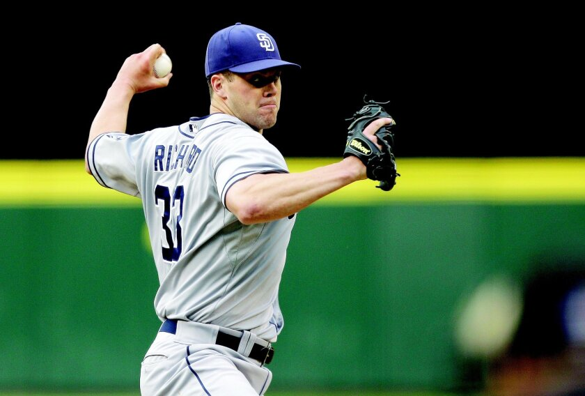 Padres starting pitcher Clayton Richard is scheduled to take the ball for Game 2 of the series-opening series at New York, but must wait a day for it. (AP Photo/Ted S. Warren)