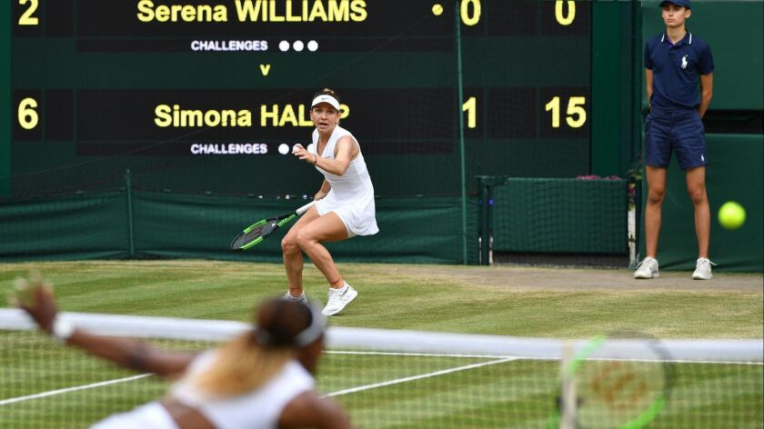 Serena Williams,, foreground, returns against Simona Halep during their women's singles final of the 2019 Wimbledon Championships.