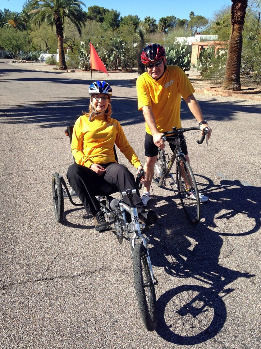 Gabby Giffords and Mark Kelly prepare to ride El Tour de Tucson