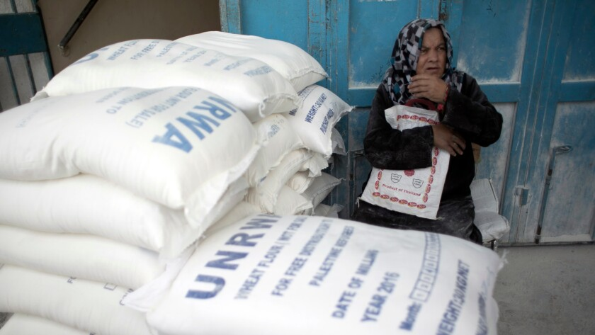 A Palestinian refugee waits to receive aid at a distribution center of the United Nations Relief and Works Agency in the southern Gaza Strip town of Khan Younis.