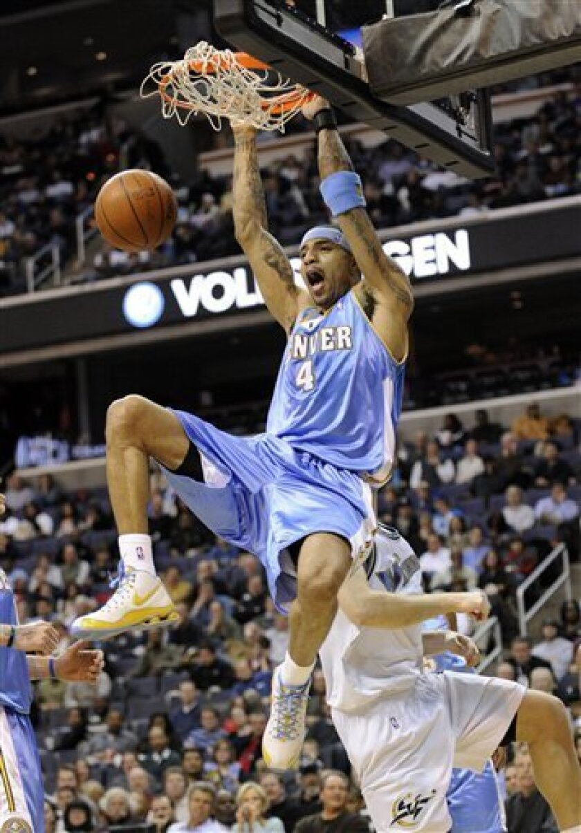 Denver Nuggets' Kenyon Martin (4) dunks against the Washington Wizards during the first quarter of an NBA basketball game, Friday, Feb. 6, 2009, in Washington. (AP Photo/Nick Wass)