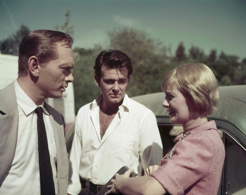 """Actors Yul Brynner, left, Stuart Whitman and Joanne Woodward, on the set of """"The Sound and the Fury"""" in Louisiana on Dec. 18, 1958."""