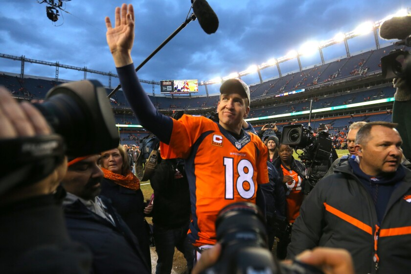 Denver Broncos quarterback Peyton Manning walks off the field after a win over the New England Patriots on Jan. 24.