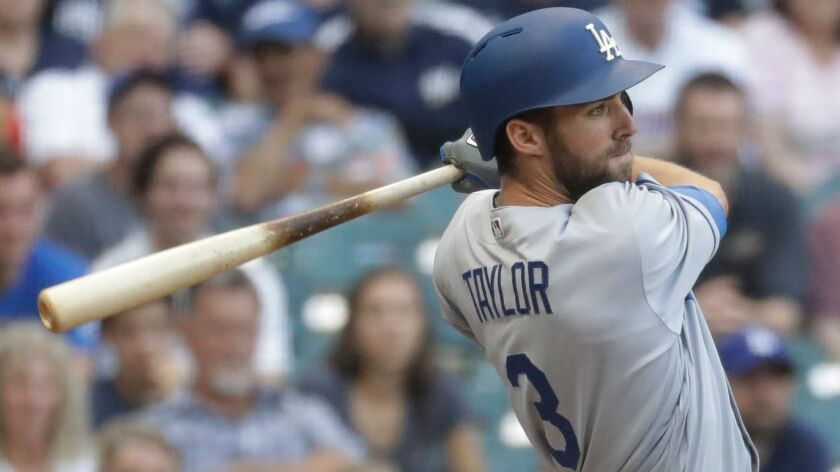 Los Angeles Dodgers' Chris Taylor hits a grand slam during the ninth inning of a baseball game again