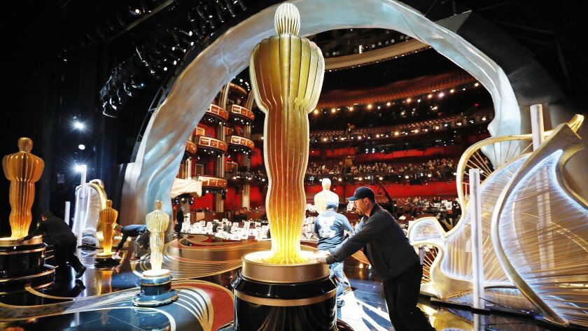 Christian Rosso with production rolls one of several Oscar statues into place onstage in the Dolby Theatre during rehearsals as preparations continue for the 91st Academy Awards.