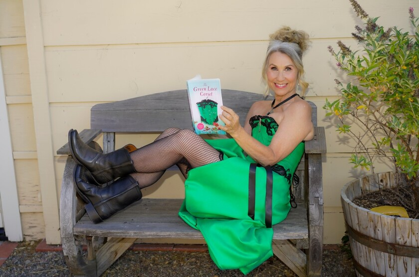 "Point Loma native Jill Hall shows her latest book, ""The Green Lace Corset."""