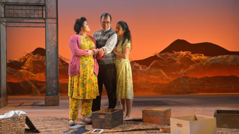 Laila (Nadine Malouf, right) and her parents (Barzin Akhavan and Denmo Ibrahim) prepare to flee thei