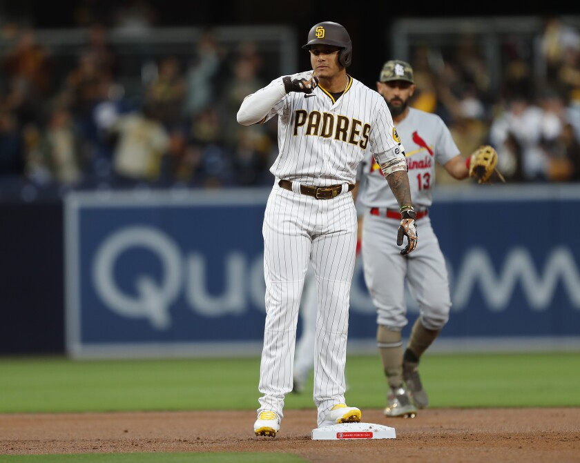 Manny Machado celebrates after hitting an RBI double on Friday at Petco Park.