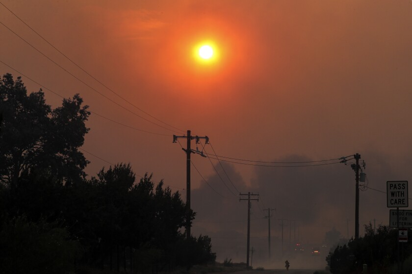 Heavy smoke from the Bobcat fire blocks the sun.