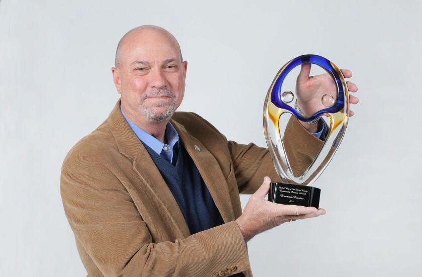 Rafe Edward Trickey, Jr., Ed.D., president and CEO of Oceanside Promise, holding his organization's 2019 United Way of San Diego County Community Partners Award.