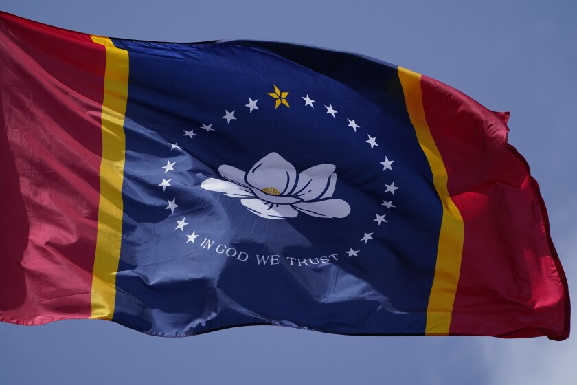 The new state flag, with a magnolia in the center, approved by Mississippi voters last week