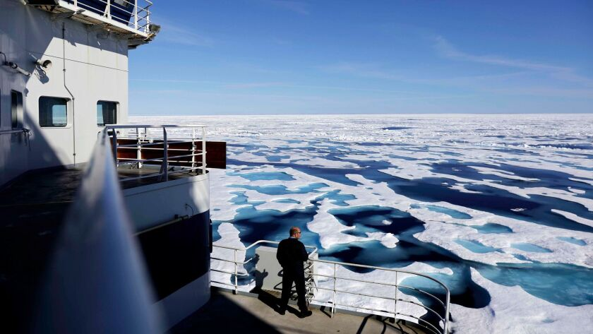 Canadian Coast Guard Capt. Victor Gronmyr looks out over the ice covering the Victoria Strait as the Finnish icebreaker MSV Nordica traverses the Northwest Passage through the Canadian Arctic Archipelago on July 22, 2017.