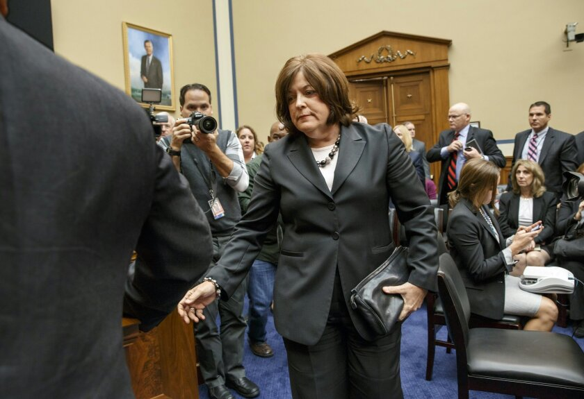 Secret Service Director Julia Pierson leaves the hearing room on Capitol Hill in Washington, Tuesday, Sept. 30, 2014, after she testified before the House Oversight Committee about details surrounding a security breach at the White House when a man climbed over a fence, sprinted across the north lawn and dash deep into the executive mansion before finally being subdued. (AP Photo/J. Scott Applewhite)