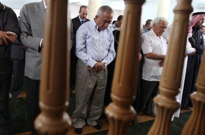 Palestinian prime minister Salam Fayyad, center, takes part in Friday prayers at a mosque following renovations undertaken after a fire, in the West Bank village of Al Mughayer, near Ramallah, Friday, June 10, 2011. (AP Photo/Majdi Mohammed)