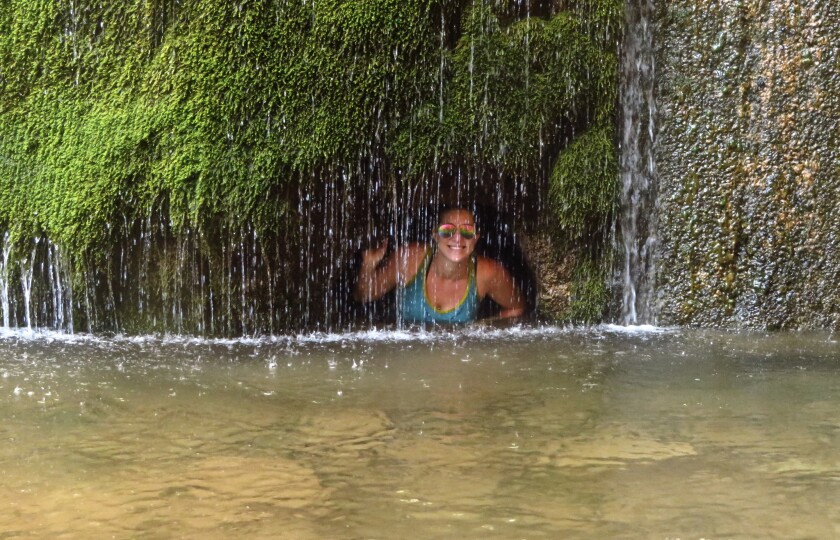 Andrea Kalash cools off at Ribbon Falls from 100 degree weather on the Rim to Rim to Rim hike at Grand Canyon National Park in 2015. The hike was 42 miles with an 11,000 elevation gainand loss in two days.