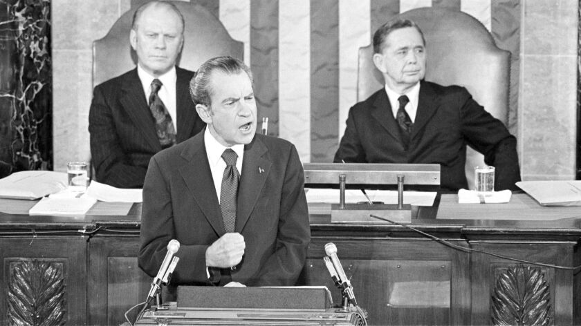 Vice President Gerald Ford and House Speaker Carl Albert listen to President Richard Nixon deliver his State of the Union address on Jan. 30, 1974.