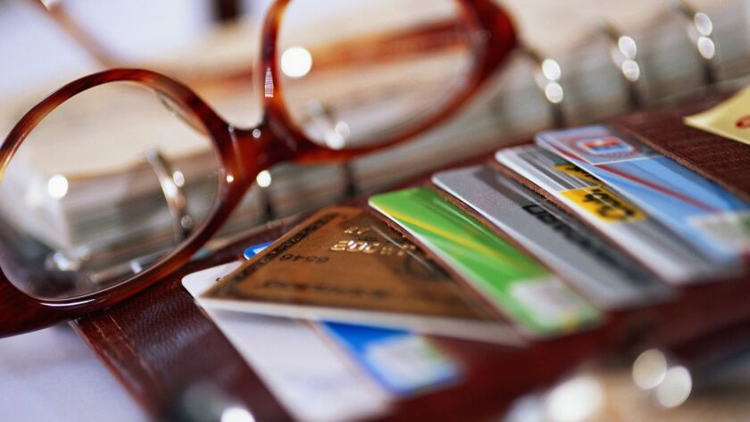 Stock of credit cards with spectacles on desk