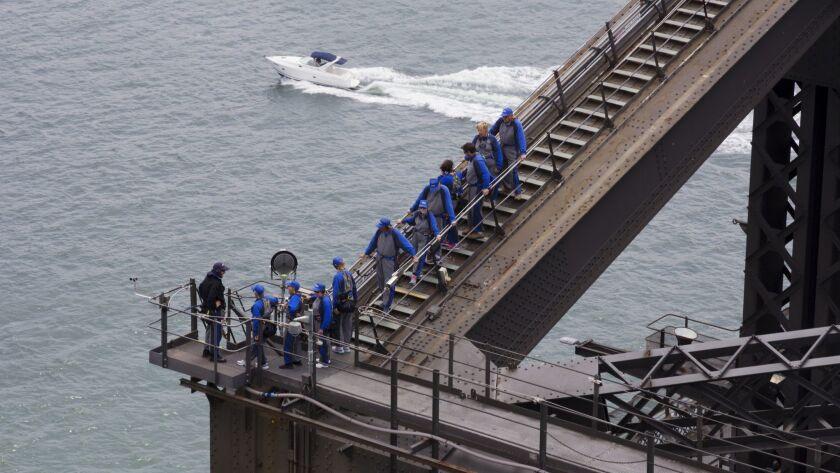 Climbing up the Sydney Bridge.