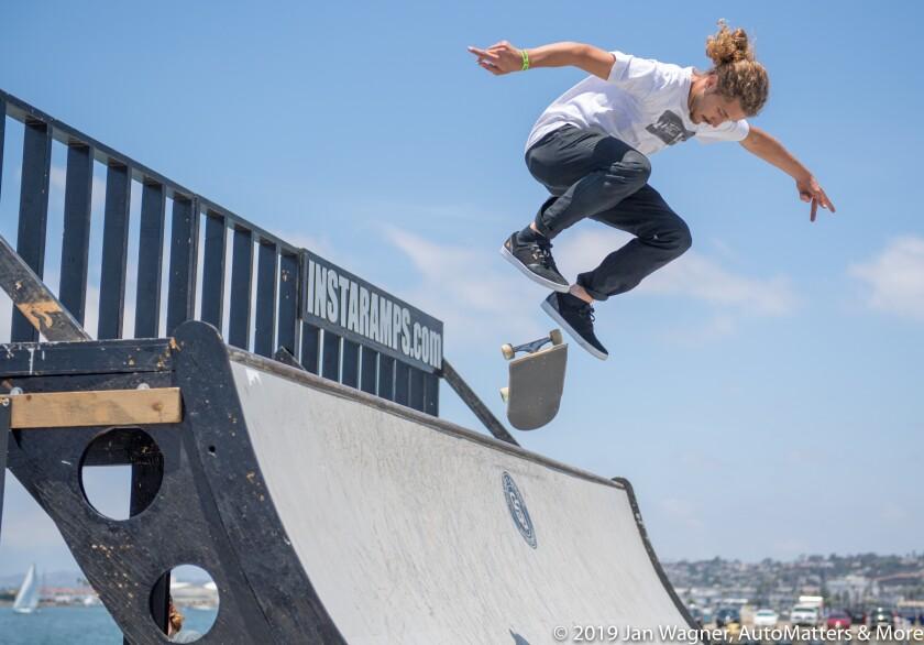 Skateboarder next to the San Diego waterfront