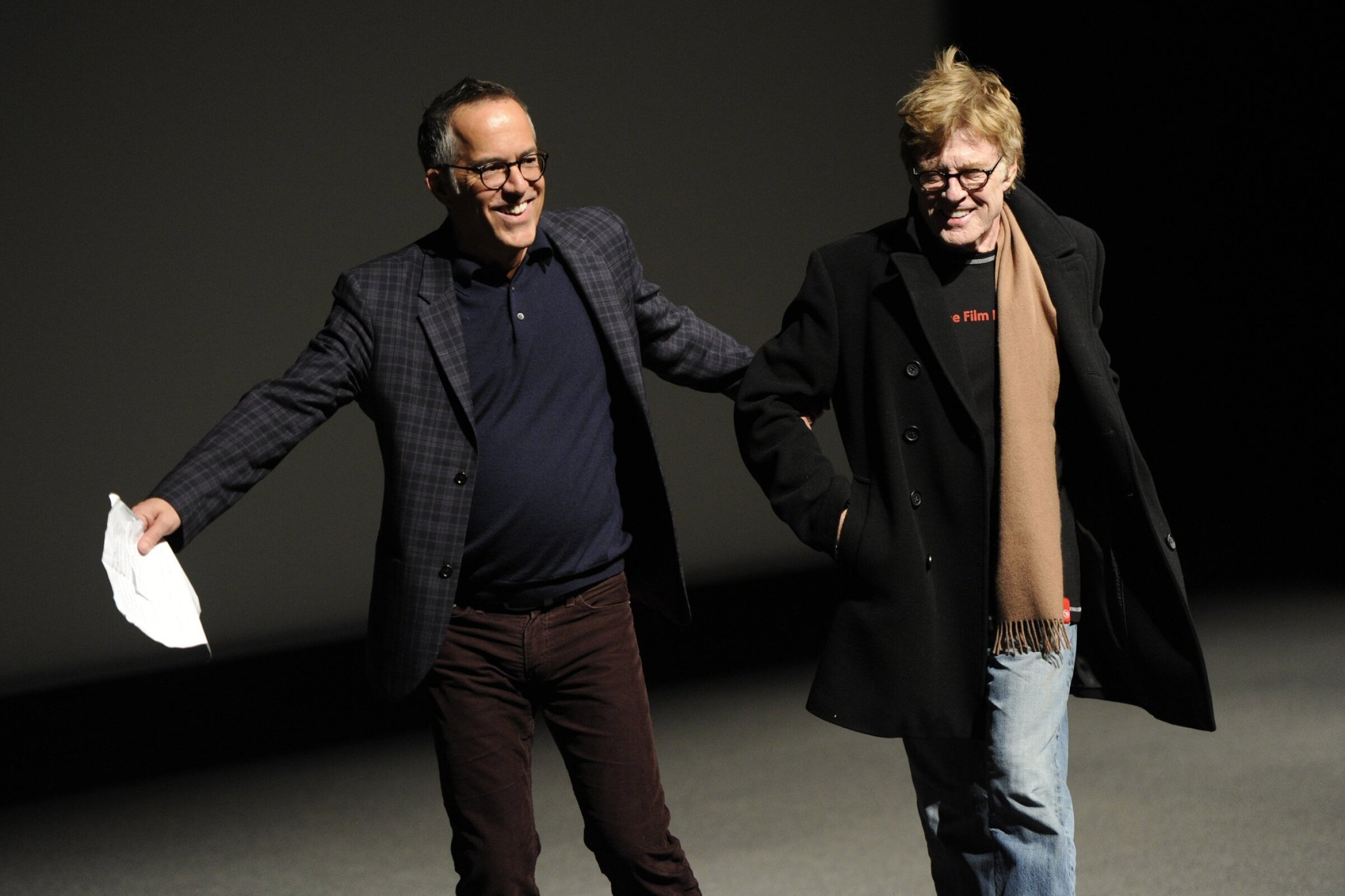 "John Cooper, left, director of programming for the Sundance Film Festival, leads Robert Redford, founder of the Sundance Institute, to the podium before the premiere of the documentary film ""What Happened, Miss Simone?"" at the 2015 Sundance Film Festival."