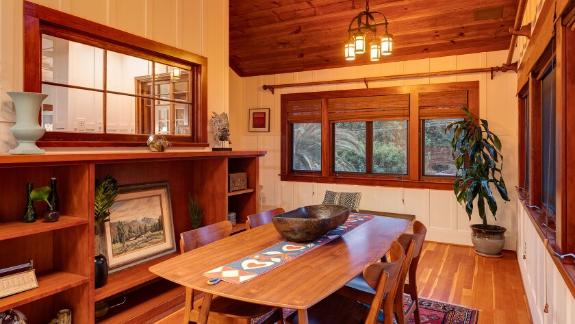 Original details in the 1912 bungalow include wood details, the hardware and the windows.