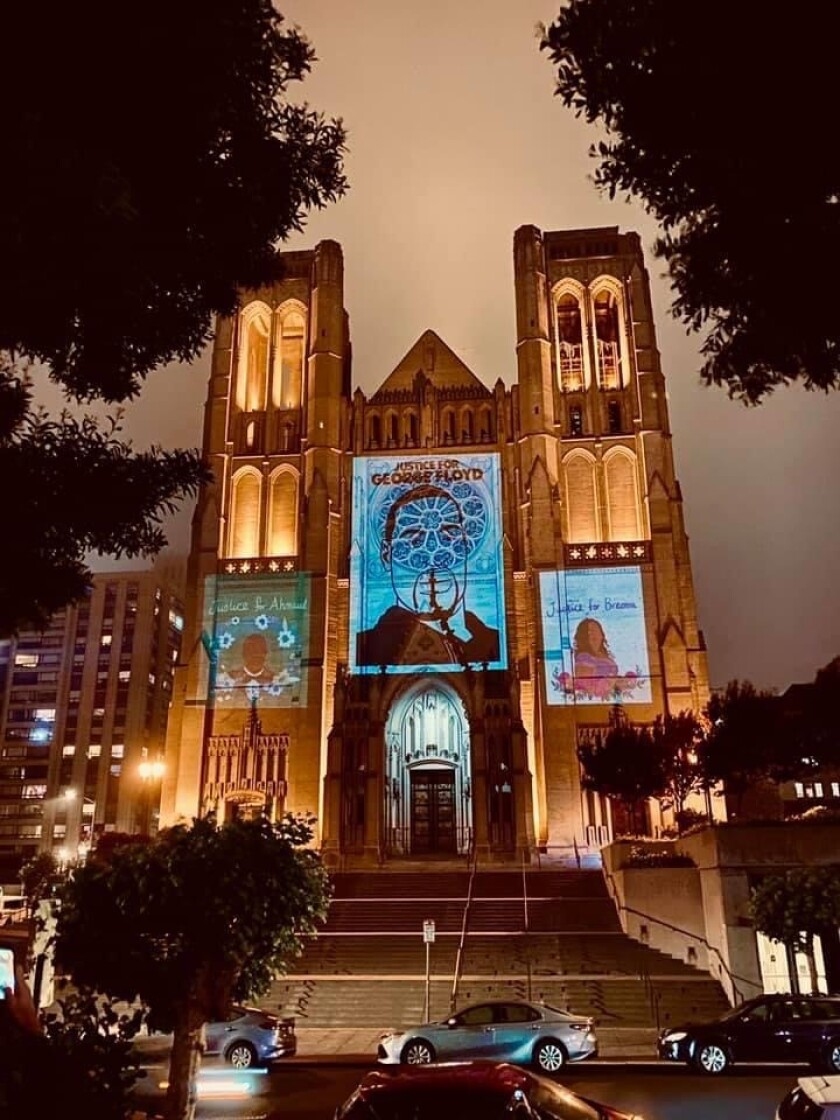 Designs of George Floyd, Ahmaud Arbery and Breonna Taylor projected onto the Grace Cathedral in San Francisco