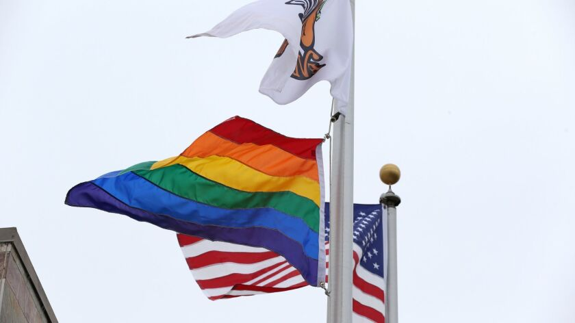 An LGBTQ pride rainbow flag flies outside the fairgrounds administration building in Costa Mesa.