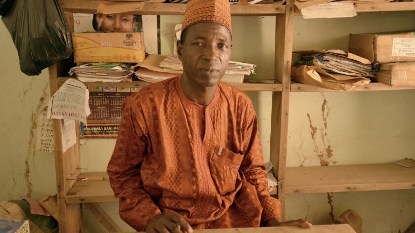 Chemistry teacher Mohammed Yahaya Nige, 50, narrowly missed being killed by Boko Haram gunmen in this office at his school in Maiduguri, Nigeria.