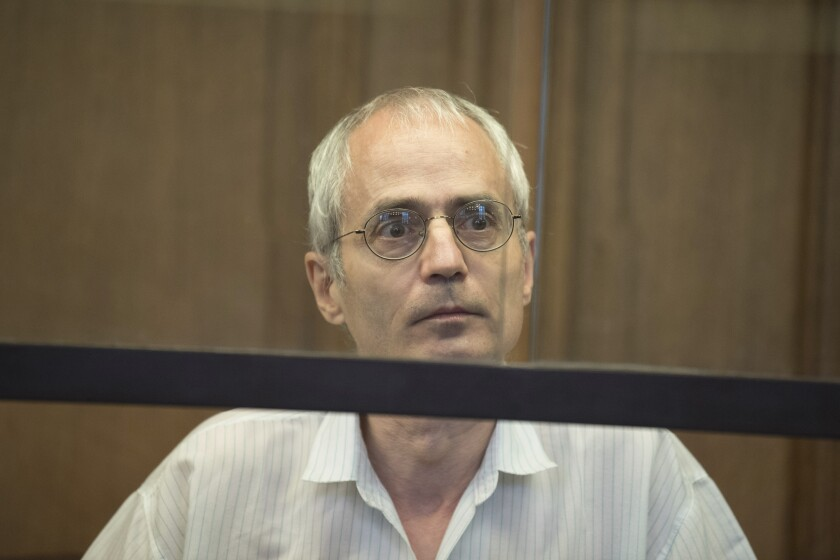 The defendant Gregor S. sits in the continuation of the trial about the deadly knife attack against the Berlin chief physician Fritz von Weizsaecker in Berlin, Germany, Wednesday, July 8, 2020. The 57-year-old defendant is charged with murder and attempted murder of a police officer. Fritz von Weizsaecker, son of former German President Richard von Weizsaecker, was killed by a stab in the neck towards the end of a lecture at the Berlin hospital Schlossparkklinik. ( Joerg Carstensen/dpa via AP)