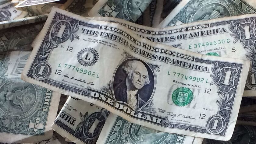 FILE - This Oct. 24, 2016, file photo shows dollar bills in New York. The Federal Reserve released a