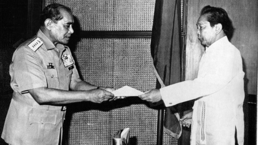 10/25/84--Armed Forces of the Philippines Chief of State Gen. Fabian C. Ver, left, hands his request