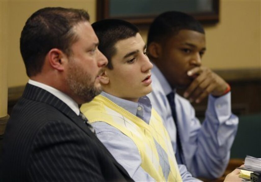From left, Defense attorney Adam Nemann, his client, defendant Trent Mays, 17, and co-defendant 16-year-old Ma'lik Richmond listen to testimony during Mays and Richmond's trial on rape charges in juvenile court on Thursday, March 14, 2013 in Steubenville, Ohio. Mays and Richmond are accused of rapi