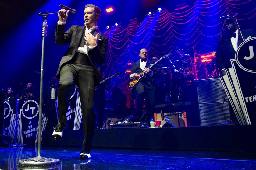"""FILE - In this May 5, 2013 file photo, Justin Timberlake performs at the MasterCard Priceless Premieres concert in New York. Nielsen Entertainment announced late Tuesday, Jan. 7, 2014, that Timberlake's """"The 20/20 Experience"""" was the year's top-selling album with 2.4 million units sold. (Photo by Charles Sykes/Invision/AP, File)"""
