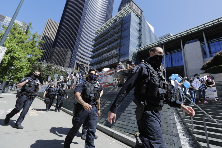 Seattle police officers in front of City Hall