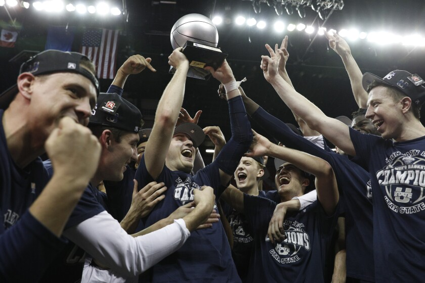 Utah State's Sam Merrill is named tournament MVP after the Aggies beat San Diego State 59-56 in the Mountain West title game.