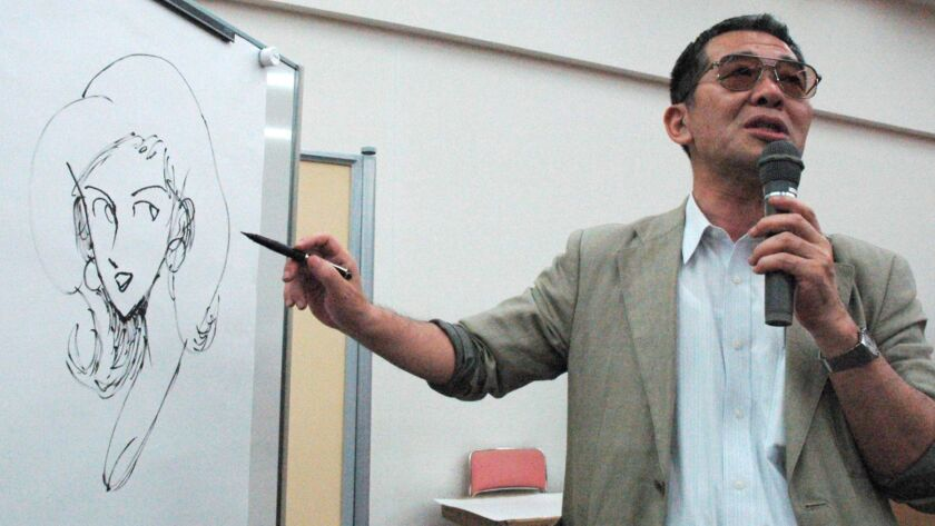 This June, 2004, photo shows cartoonist Monkey Punch drawing his character Fujiko Mine on whiteboard