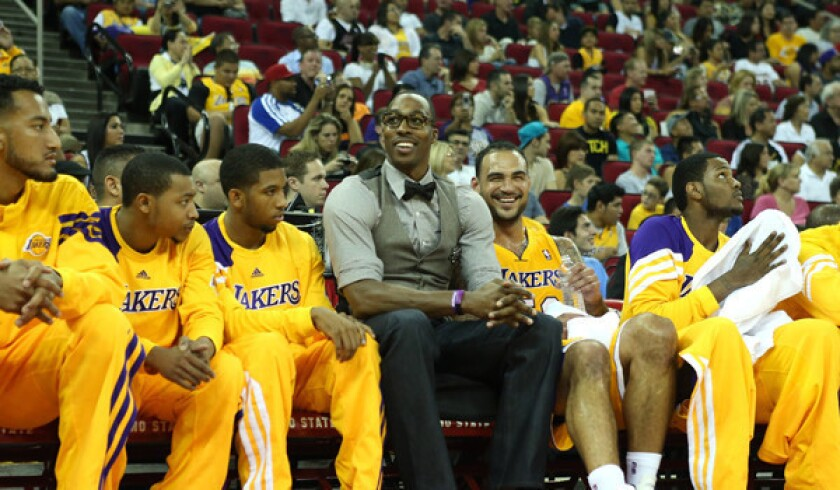 Lakers center Dwight Howard jokes with teammates on the bench in a game against the Warriors earlier this month.