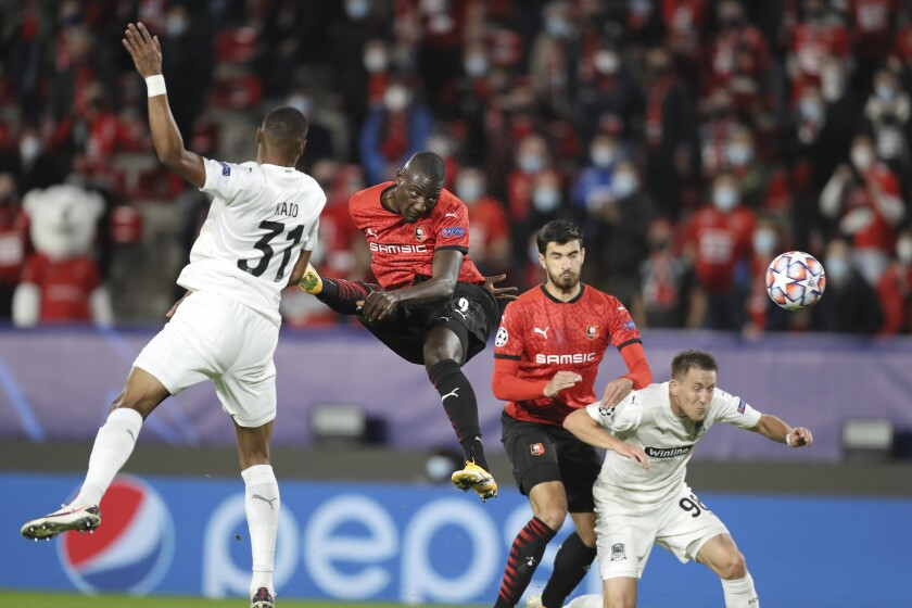 Rennes' Serhou Guirassy, centre, heads the ball during the Champions League, group E soccer match between Rennes and Krasnodar at the Roazhon Park stadium in Rennes, France, Tuesday, Oct. 20, 2020. (AP Photo/David Vincent)