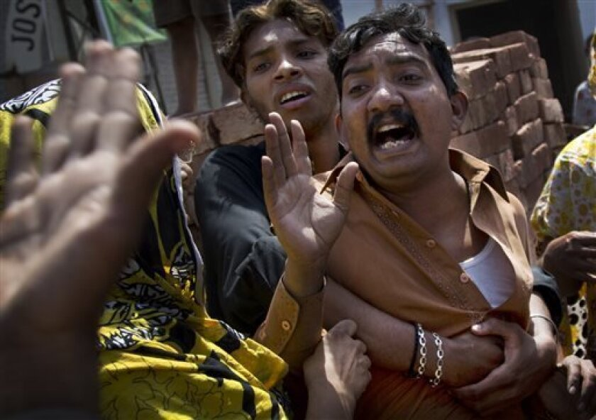 This Tuesday, April 30, 2013 photo shows angry Pakistani Christians protesting the beating of a young Christian boy belonging to the Joseph Colony in Lahore, Pakistan. Minority Christians in Pakistan have little hope that the May 11, 2013 general elections will help them. Christians are part of the four percent of Pakistanis who belong to minority religions. (AP Photo/Anja Niedringhaus)