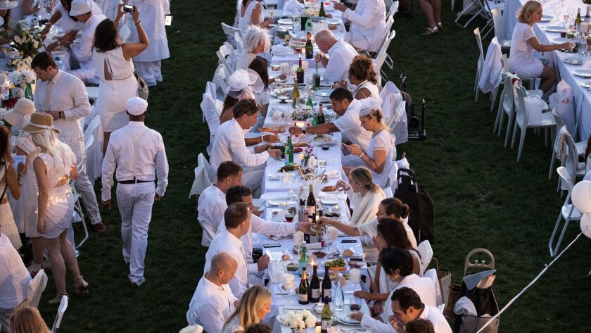 Thousands of people attend this year's Diner en Blanc pop-up dinner in New York City. The Los Angeles Diner en Blanc is scheduled for November.
