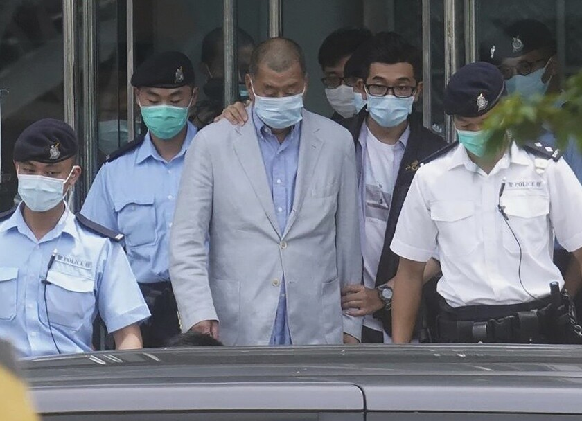 Hong Kong tycoon Jimmy Lai, center, who founded the newspaper Apple Daily, was arrested Aug. 10, 2020.