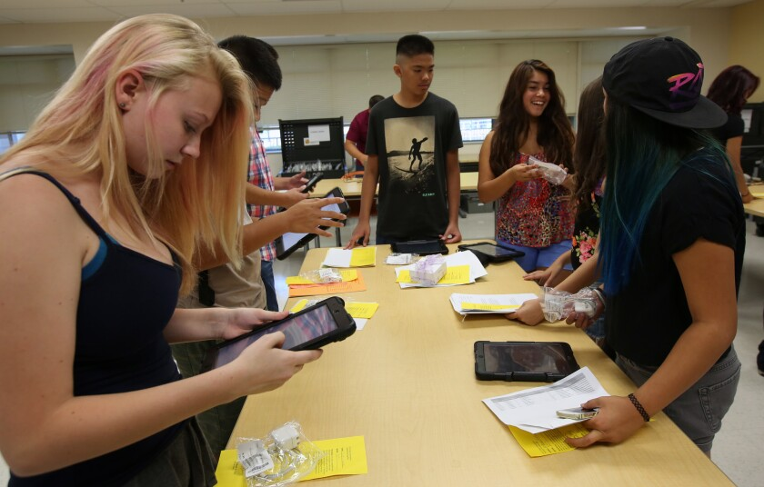 Students at the Valley Academy of Arts and Sciences in Granada Hills get iPads as part of their pre-first day orientation this month.