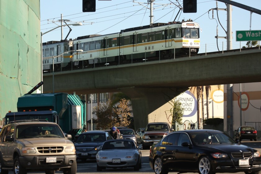 A Metro train crosses National Boulevard at Washington Boulevard to arrive at the Expo Line Culver City Station on Nov. 16.