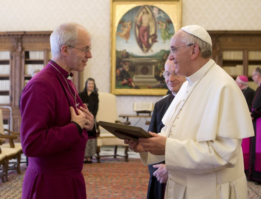 Pope Francis, right, talks with Archbishop of Canterbury Justin Welb on Friday prior to a private audience at the Vatican.