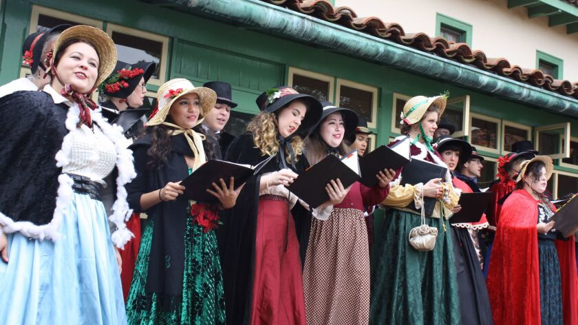 Carolers sing at an Old Time Christmas Festival at Rancho Los Cerritos in Long Beach.
