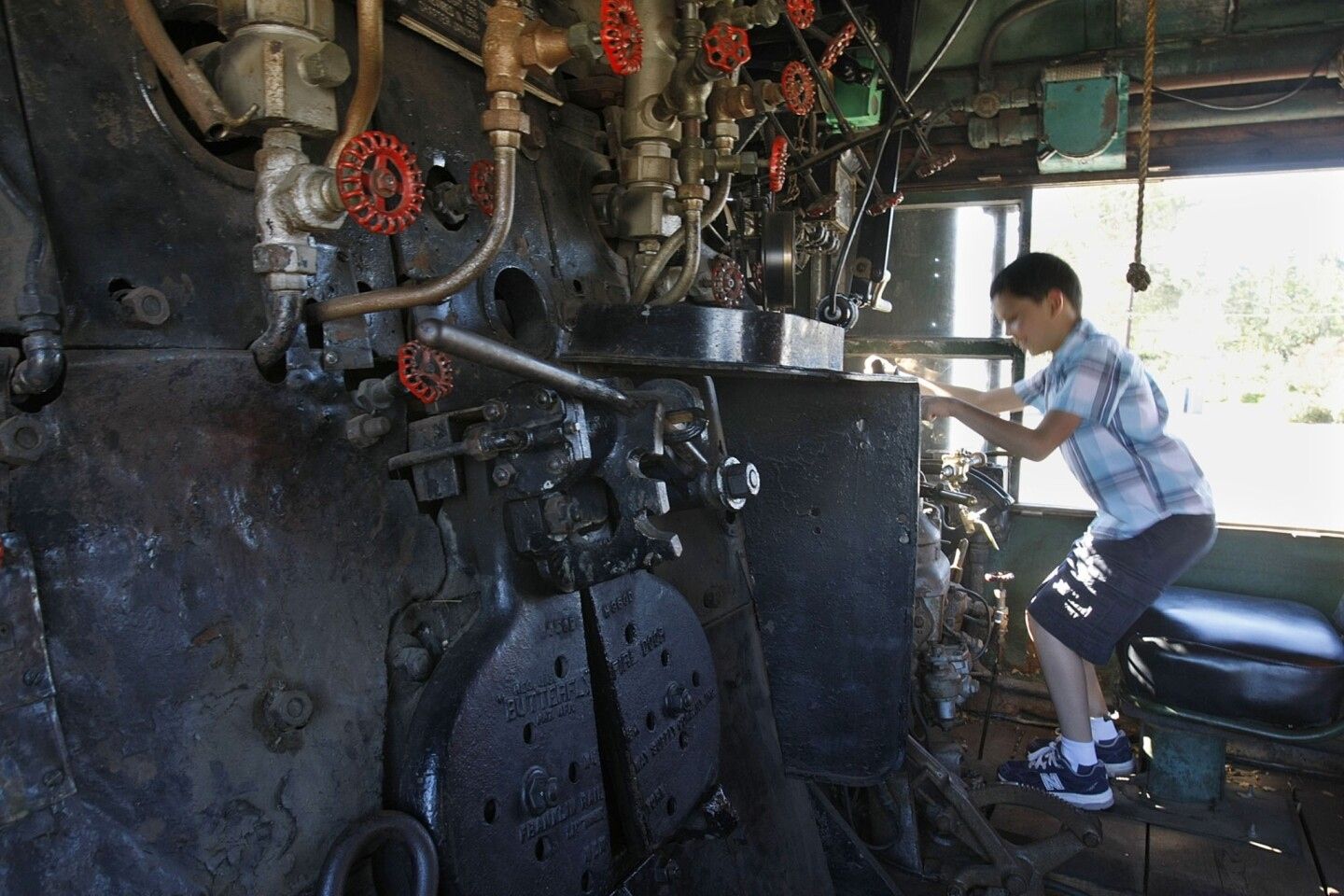 Benjamin Garza, 9, of Calabasas sits inside the cab of Union Pacific's No. 4014. The train is being converted from burning coal to using fuel oil and is being restored as a traveling museum.